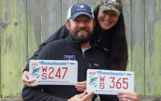 Cynthia and Ben Wigren with the new Massachusetts Atlantic White Shark Conservancy license plates. COURTESY PHOTO  (photo: )