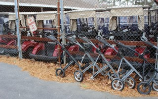 In the present cart barn at Cranberry Valley Golf Course the golf carts and push carts are stored outside due to a lack of space. WILLIAM F. GALVIN PHOTO    (photo: William F. Galvin)