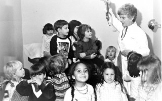 Nurse Practitioner Lee Fuller with a group of preschool kids. 1983. FILE PHOTO  (photo: )