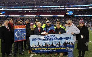 Rick Glasheen of Harwich receives a commemorative football from New England Patriots owner Robert Kraft after having his name chosen among thousands as the Designated Driver of the Season. Contributed Photo  (photo: )