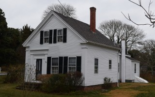 This house on Stage Harbor Road, currently under a demolition delay imposed by the historical commission, is one of several antique homes in the neighborhood officials say would be better protected under a National Historic Register District designation. FILE PHOTO  (photo: )