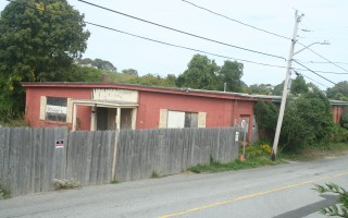 The former Chatham Bowling Alley, more recently used as a warehouse by owner Chatham Bars Inn, is the subject to ongoing negotiations between the inn and town regarding its future use. FILE PHOTO 