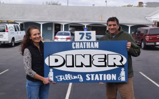 Ric and Caren Morse with the new sign for their new diner, The Chatham Filling Station. TIM WOOD PHOTO  (photo: )