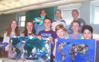 Nauset Regional Middle School students display two works they'll exhibit through June 19 around and in the community building at 44 Main St. Front, left to right: sixth graders Audrey Merchant, Bailey Kavanaugh, Sophia Easley, Chris Barber, Patrick O'Keefe, and David Sargsyan. Back: Grace Curtis, Ava Doyle, Malcolm Stewart 