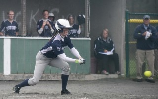 On a foggy Monday afternoon, Eliza Hawthorne lays down a bunt during Monomoy's Div. 3 tourney game against Bristol-Plymouth. Caitlin Daley Photo  (photo: )