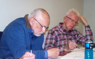 Bob Renn, left, and Ken Rowell of the revenue committee reviewed documents at their May 31 meeting. They were preparing a presentation to the selectmen and finance committee scheduled for June 21. ED MARONEY PHOTO  (photo: Ed Maroney)