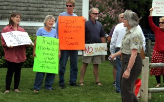 Protesters wave signs outside a public hearing on the Monomoy Comprehensive Conservation Plan in June 2014. FILE PHOTO  (photo: Alan Pollock)