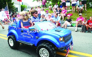 Hey! There's a parade behind us! These kids were seriously about navigating last year's entry from the Oyster River Boatyard down Main Street. The boatyard and at least 100 other entries will be back for next Tuesday's parade. KAT SZMIT PHOTO  (photo: )