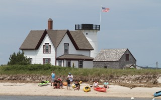 Kayakers pull up to the beach at Stage Harbor Light during an excursion. The Coast Guard encourages paddlers to have life jackets, a distress light, and a whistle while paddling in areas such as Pleasant Bay and Stage Harbor, and flares when venturing into open water. ALAN POLLOCK PHOTO  (photo: )