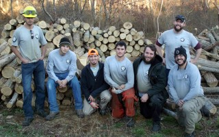 The AmeriCorps Cape Cod team that cleared invasive locust trees from the Pleasant Bay Woodlands last fall included (from left)   Sam Gilvarg, Hunter Moore, Ryan Souto, Joseph Bell, Bradley Falco, Julien Garcia and (in rear) Alex Smith. COURTESY PHOTO    (photo: Matt Cannon)