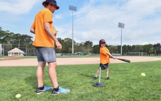 Max Burt assists Ryder Young in an at-bat during the June 30 clinic, which also featured a game of Pickle, as well as various skill drills. Kat Szmit Photo  (photo: )