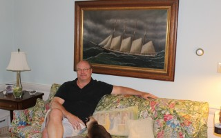 "Duncan Berry talks about his sea captain ancestors who built homes along Captains' Row in West Harwich. The painting of the barque ""Jonathan Bourne"" provides a seafaring atmosphere in his home. WILLIAM F. GALVIN PHOTOS  (photo: )"