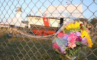 A bouquet rests on the fence outside Coast Guard Station Chatham.  ALAN POLLOCK PHOTO  (photo: Alan Pollock)
