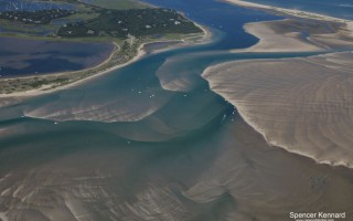 Extensive shoaling between Morris Island, on the left, and Monomoy, on the right – seen in this aerial photo taken July 21 – has made it difficult for boats to access the new break in South Beach which provides a direct route to the Atlantic. SPENCER KENNARD PHOTO  (photo: Spencer Kennard)
