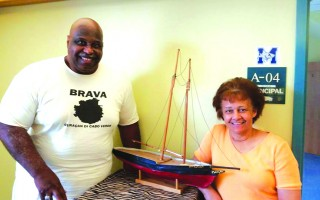 Robert Cutts and Barbara Burgo with a model of the schooner Ernestina, the last ship to bring immigrants to this country under sail from the Cape Verde Islands. The real Ernestina is a National Historic Landmark.  JENNIFER SEXTON-RILEY PHOTO  (photo: Jennifer Sexton-Riley)