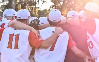 Orleans Firebirds players gather in the glow of the setting sun for one more pregame pep talk before their last game of the 2017 season Aug. 10. Kat Szmit Photo  (photo: )