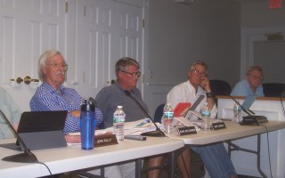 Seated off the dais as they attend a meeting of the finance committee Aug. 17, selectmen (left to right) Alan McClennen, Mefford Runyon, Mark Mathison, and Jon Fuller listen to reports on wastewater project options. Ed Maroney Photo  (photo: )