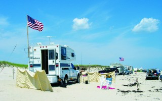 Campers on North Beach. Orleans and Chatham are negotiating over whether Chatham will resume beach patrols of its section of the barrier spit. FILE PHOTO  (photo: Timothy J Wood)
