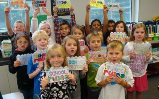 First graders at the Harwich Elementary School reinforced the SHARK expectations by completing a school rules book. Students chose two rules that they learned for each area in the school: playground, cafeteria, hallway, bus and in the classroom.  (photo: )