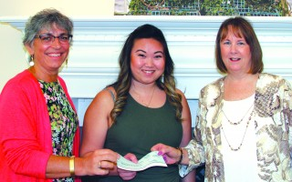 Former Harwich Junior Woman's Club President Antigone London (left) and former clerk Debra DeCosta (right), with Cooperative Bank of Cape Cod manager Crissy Phan (center), deposit the check from the Unclaimed Property Division into an account. The money is being distributed to local organizations this week. COURTESY PHOTO  (photo: )