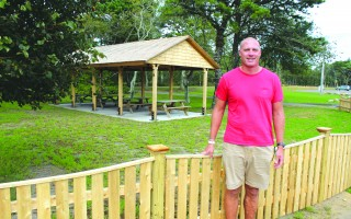 Recreation Director Eric Beebe displays the new fencing and picnic pavilion in Brooks Parks. The recreation department's five-phase plan for improvements in the park is nearing completion. WILLIAM F. GALVIN PHOTO  (photo: )