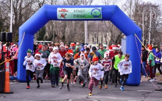Runners of all ages take off from the start line of the 2017 Santa Stampede in Orleans on Dec. 2. Kat Szmit Photo 