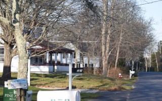 The town assessing department is tracking sales of antique homes, some of which have been below the assessed values. Two sales in the Stage Harbor Road neighborhood, above, were significantly lower than their assessed value. TIM WOOD PHOTO  (photo: )
