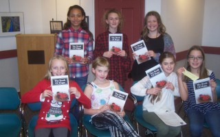 Young poets from Orleans Elementary School gathered at Snow Library to read their work in  The Book of Hope.  Left to right, back row: Melody Sieger, Annika Van der Wende, Fiona McCray; front row: Emily Decker, Brie Kinzer, Saffron Jalbert, Molly Filteau.  ED MARONEY PHOTO  (photo: Ed Maroney)
