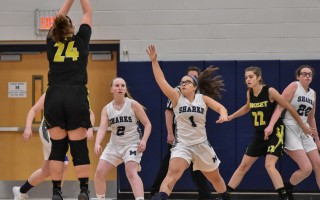 Monomoy's Kelsey Olson (1) and Maggie Dever (2) work to stop Nauset's Skyeler Sandison (24) from finding the net during game play Dec. 15 at Monomoy.  KAT SZMIT PHOTO  (photo: Kat Szmit)