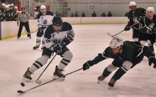 Monomoy's Lucas Tambolleo (16) battles an Abington opponent for control of the puck during the Monomoy-Mashpee Monarchs hockey game on Dec. 13.  KAT SZMIT PHOTO  (photo: KAT SZMIT)