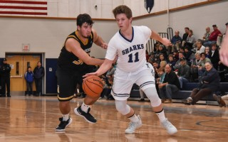 Monomoy's Christian Blakeley (11) works to keep the ball away from Nauset's Spencer Jones (33) during game play Dec. 15 at Monomoy.  KAT SZMIT PHOTO  (photo: Kat Szmit)