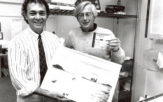 "Richard Kirk (left) displays the original artwork he produced for ""Concord All Stars on Cape Cod,"" while Larry Marsland, his partner in Kirk/Marsland Advertising, Inc., displays the finished product. Tim Wood photo. 1992. FILE PHOTO  (photo: )"