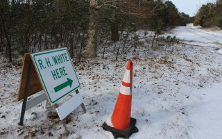 The sign at the end of Cypress Point Road in East Harwich directs vehicles into the pit where National Grid gas pipeline construction materials are being stored off Route 39. The content of those materials has been called into question by one neighbor. WILLIAM F. GALVIN PHOTO  (photo: )