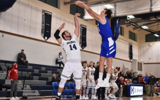 Monomoy's Jake Wisniewski (14) attempts to launch a shot above the arms of St. John Paul II's Nate Whiteley (15) during game play at Monomoy on Jan. 5. Kat Szmit Photo  (photo: Kat Szmit)