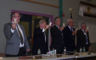 Town Administrator John Kelly and (to his left) selectmen Jon Fuller, Mark Mathison, Alan McClennen, and David Dunford vote the traditional way at town meeting in October 2016. The option of electronic voting will be on the board's agenda Feb. 7. FILE PHOTO  (photo: )