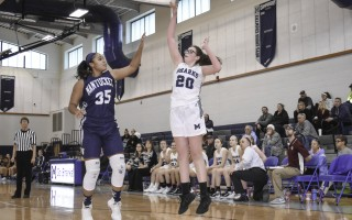 Monomoy's Erin Starkey (20) launches a shot above the reach of Nantucket's Jadelen Howard (35) during game play at Monomoy on Jan. 20. Kat Szmit Photo 