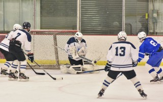 Monomoy/Mashpee Monarchs goalie Jack Daigneault deflects the puck during game play against Upper Cape Tech on Feb. 10.  KAT SZMIT PHOTO  (photo: Kat Szmit)