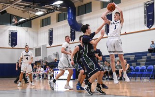 Monomoy's Connor Santoni (1) takes aim at the hoop while under pressure from a trio of East defenders.  KAT SZMIT PHOTO  (photo: Kat Szmit)