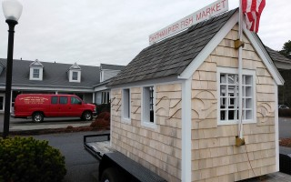 This playhouse, built by Cape Associates and modeled after the Chatham Fish Pier Market, is being raffled to benefit the playground project, Monomoy Community Services and Women of Fishing Families. ALAN POLLOCK PHOTO  (photo: )