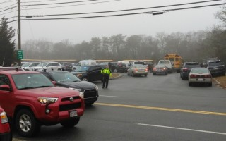 Students and school buses staged at the commuter parking lot on Route 124 until police cleared the school to open.  ALAN POLLOCK PHOTO  (photo: Alan Pollock)