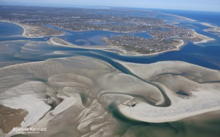 The huge amount of sand flowing through the Morris Island cut from the inlet in South Beach is starkly visible in this aerial photo taken Feb. 24. SPENCER KENNARD PHOTO  (photo: )