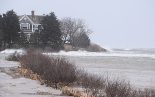 Surf pounds a seawall at a North Chatham home during Saturday's high tide. TIM WOOD PHOTO  (photo: )