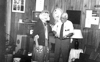 "Chatham Housing Authority Director Henry Welch helps ""No One,"" (Chatham Fire  Department  firefighter/paramedic  Kate Hansen) the homeless clown, introduce fire safety concepts before an  audience of authority residents. 1998. FILE PHOTO   (photo: )"