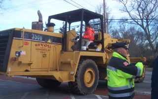 Police Lt. Kevin Higgins kept an eye out as Revoli Construction's pavement grinder moved into position on Main Street.  ED MARONEY PHOTO  (photo: Ed Maroney)