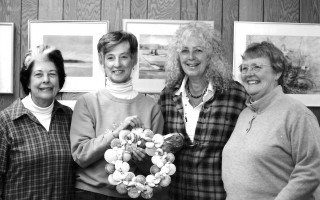 Marilyn Jensen, Mary Parsons, Gail Tilton and Charlotte Edgecombe holding a scallop shell wreath for the Crustacean Fair. 2001.  FILE PHOTO  (photo: )