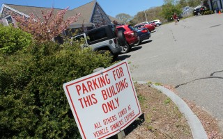 The sign at the entrance to the Village Center Shops in Harwich Port demonstrates the significance of parking in the village.  WILLIAM F. GALVIN PHOTO  (photo: William F. Galvin)
