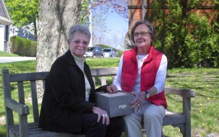 DeeDee Holt and the longest serving board member, Eunice Burley, look through the Friends of Trees archives in front of Eldredge Public Library.  BENJAMIN THOMAS PHOTO  (photo: Benjamin Thomas)