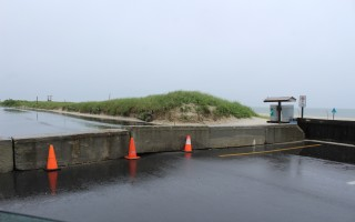 Concrete barriers have been installed across one-third of the parking lot at Red River Beach and are expected to remain for the rest of the month to protect four piping plover chicks which hatched on Friday. A section of the beach is also closed. WILLIAM F. GALVIN PHOTO  (photo: William F. Galvin)