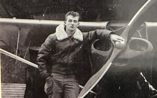 "Charles P.H. ""Chief "" Bascom as a young man, possibly a teenager, next to his airplane in front of the hanger behind the family's house on Church Street. PHOTO COURTESY OF DEBE BASCOM SCHIAVI  (photo: Courtesy Photo)"