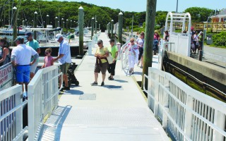 The new ADA compliant public ramp system for passenger and recreational boats at Saquatucket Harbor is a shining example of handicapped accessibility. WILLIAM F. GALVIN PHOTO  (photo: William F. Galvin)